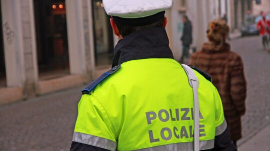 policeman in uniform of the municipal police in Italy during a s